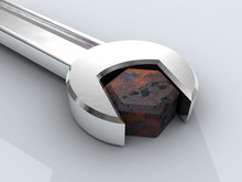 Rusty Bolt And Chromium Wrench