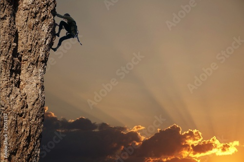 Alpinisme climber on sunset on the rock