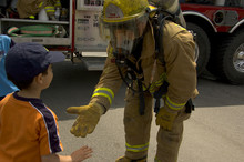 Firefighter In Uniform With A Child
