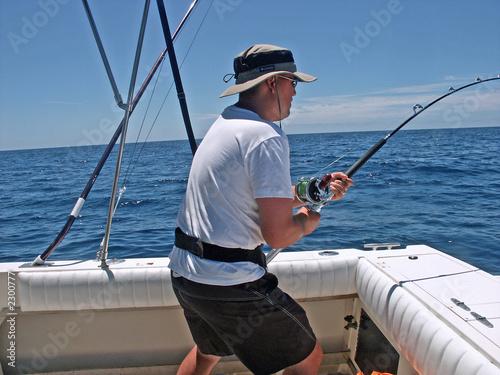 Foto op Plexiglas Vissen reeling in