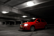 Red Hatchback Car On Black And...