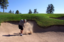 Golfer Hitting Out Of A Sand T...