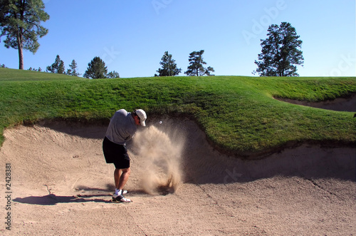 Canvas Print golfer hitting out of a sand trap (2 of 3 shot act