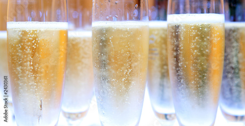 Fotografie, Obraz  group of champagne glasses filled with bubbles