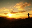 canvas print picture - man silhouette on sunset