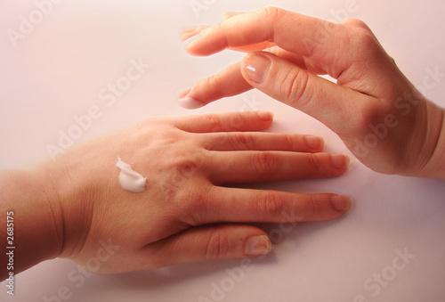 female hands applaing a cream #2685175