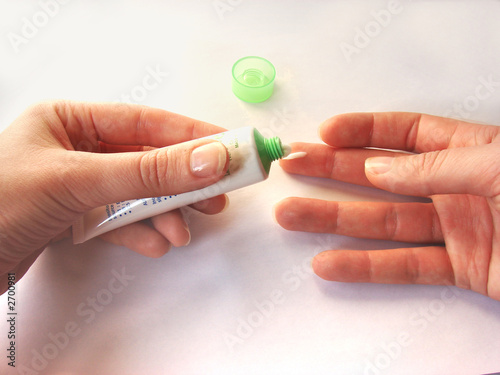 female hands applaing a cream close up. #2700981