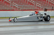 canvas print picture - dragster heads down the track