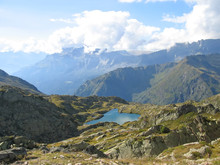 Small Lake With Clouds Reflection, Aiguillette Des Houches, Brev