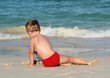 little boy on a tropical beach