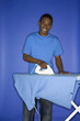 african-american teen boy ironing.