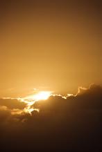 Sun Peeking Through Cloud.