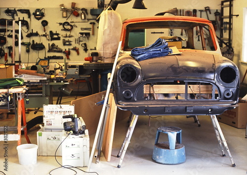 Garage with an old car being repaired - auto repair shop © Jette Rasmussen
