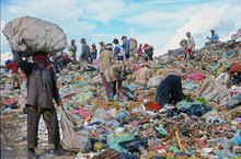 Poor People Working In A Rubbish Dump
