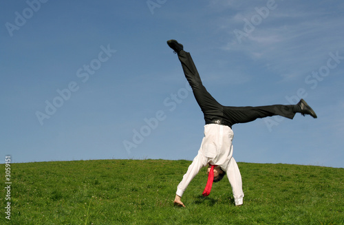 Fotografie, Obraz  businessman doing cartwheel outdoors