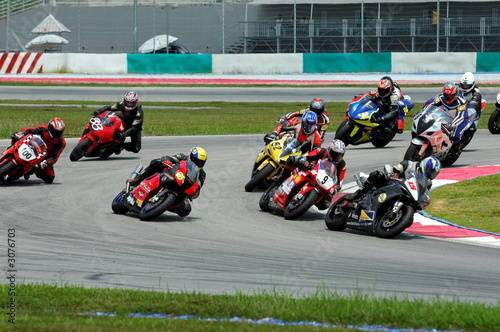 Poster Motorsport race bikes at a race track