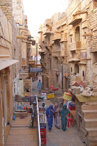city street with indian women walking, jaisalmer, india #3113184