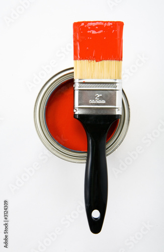 paint brush with red paint and paint can