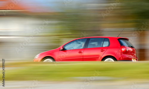 Obraz na plátne fast moving red car