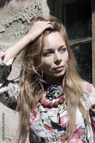 Canvas Prints Dragons beautiful young woman at the wall, half colored