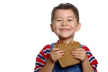 Boy With Peanut Butter Sandwich On Whole Wheat Bre