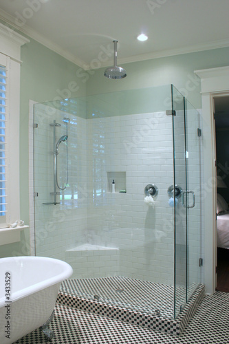 Valokuva  luxurious bathroom with glass and tile