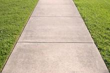 Sidewalk And Grass Converging ...