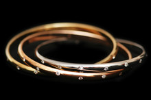 Three Gold Bracelets  Isolated On The White