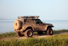 Jeep On Shore In Sunset Rays