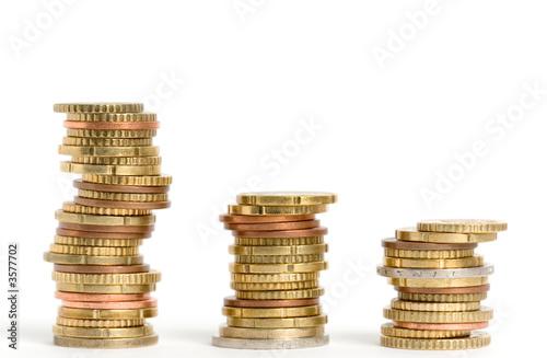 Fotografía  Three stacks of euro coins on white background