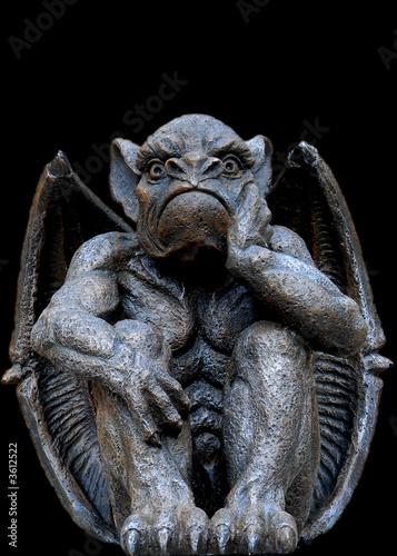 Obraz na plátne Scary looking Gargoyle sitting inside his wings