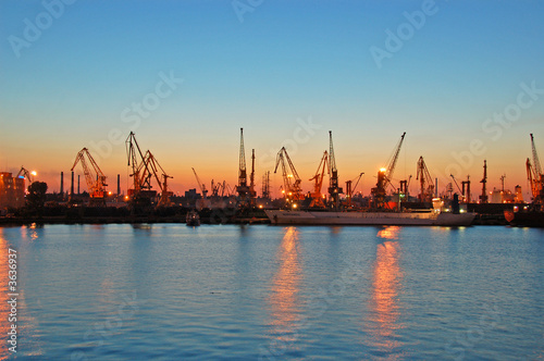 Photo Stands Antwerp harbour scape with cranes