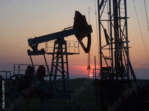 Fototapeta sunset  through the gas produce tower  obraz na płótnie