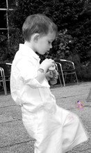 A French Boy Plays With Bubbles, In Monochrome, Colourised