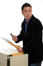 A Man Slipping Documents Out O...