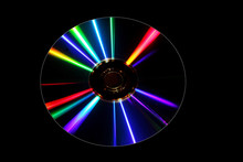 DVD Disk With Diffractive Patterns Isolated On Black Background
