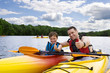 canvas print picture - Father and son enjoying kayaking