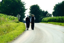 Amish Couple Walking Down A Co...