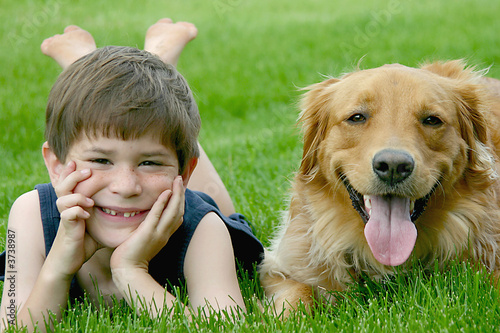 Photo  Young Boy With Dog