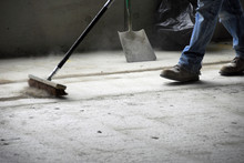 Construction Worker Sweeping Up