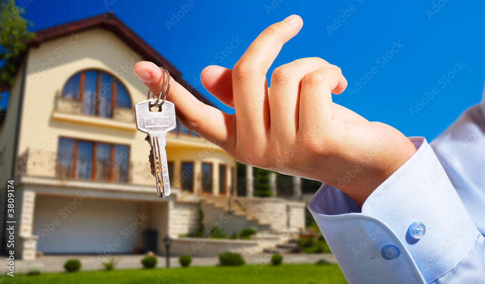 Fototapeta House owner/real estate agent giving away the keys