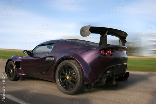Race car in motion Slika na platnu