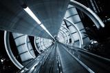Futuristic architecture. Tunnel with moving sidewalk