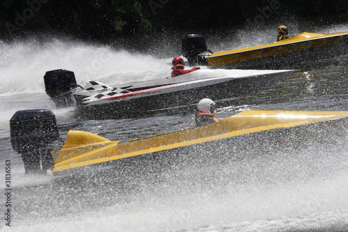 Speed boats in a race
