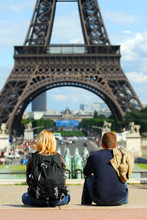Young Tourists Enjoying The View Of Eiffel Tower In Paris.