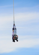 Couple Bungee Jumping Off A To...