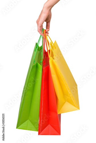 Photo Stands Female hand with packages on a white background