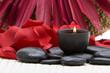 Leinwandbild Motiv Spa candle, stones and rose petals