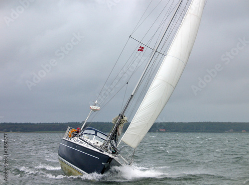Garden Poster Sailboat racing in the winter in strong winds and rough sea
