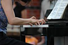 Young Woman Playing Piano Duri...